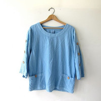 vintage boxy blouse. loose fit cotton shirt. slouchy blue minimalist top. wooden buttons & pockets. casual lifestyle shirt.
