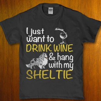I just want to drink wiine and hang with my sheltie Women's t-shirt