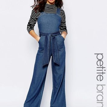 Boohoo Petite Pinny Tie Waist Denim Jumpsuit at asos.com