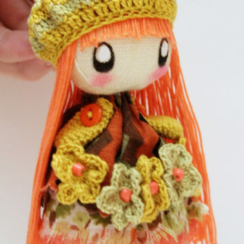 Textile brooch Ivi orange and green flowers doll