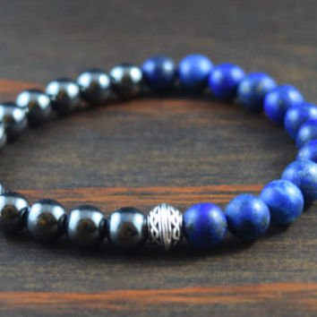 Opposites Attract! Men's Beaded Bracelet. Matte Lapis Lazuli and Hematite Bracelet. Celtic Knot Bracelet. Lotus and Lava Bracelet.