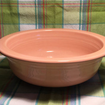 Fiestaware. Peach bowl. 8 1/2 inches across bowl top. Fiesta Ware bowl. Collectable.
