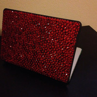 Red and black MacBook 13 in case