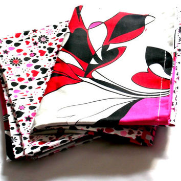 Pair of Pillowcases featuring pinks and blacks with hearts