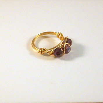 "STAR RISING - Tripled Wrapped Ring in Gold Wire 3 Iridescent Crystal Bi-cones. Wire Wrapped Ring is a Size 6 1/2""."