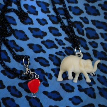 Ivory Elephant Charm Necklace with Heart at closure