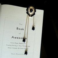 Silverplated bookmark with an ivory and black rose by Arthlin