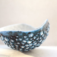 Cobalt blue English fine bone china stoneware bowl with a unique textured surface.