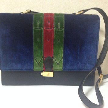 80s Vintage Roberta di Camerino red, navy, and green ribbon velvet shoulder purse with golden R motif closure. Classic bag