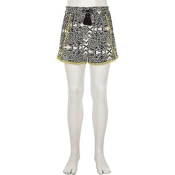 Girls black aztec print crochet trim shorts