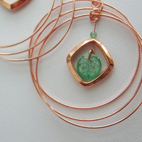 Copper giant hoop earrings with resin green and by underglass