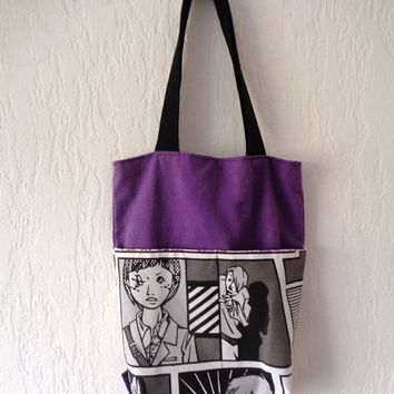 Fabric handbag with pockets. Black and white comic book print with purple lining.