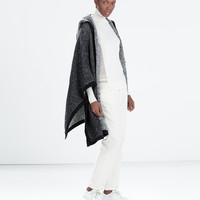 Piped hooded two-tone poncho