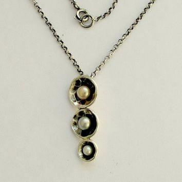 Sterling silver bowls pendant with pearls suspended on a silver chain - Long ago.