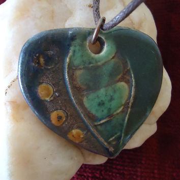 Handmade ceramic pendant. Leaf shape. Green with dark yellow spots. FREE SHIPPING!