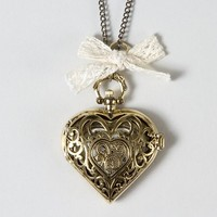 Filigree Heart Locket Pendant Necklace with Bow – Claire's
