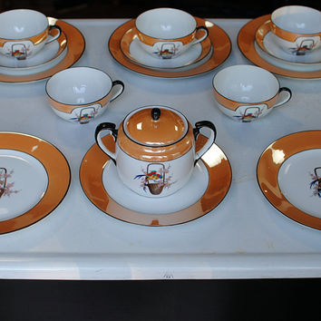 Rare Art Deco Noritake orange lusterware fine china with hand painted parrots - set of japanese tea cups, plates, and sugar bowl