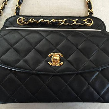 MINT. 80's vintage Chanel black lamb leather trapezoid shape 2.55 flap shoulder bag with white pipings and golden chains. Unique purse.