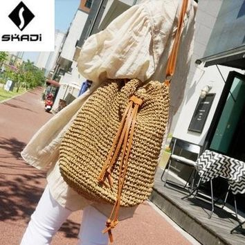 Women's Bags New Redskins with the best selling solid color straw bag tassel buckets oblique beach bag woven bag