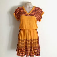 Vintage 1980s multi stripe/plaid orange two piece skirt and top combination with fine gold lurex thread and fringing