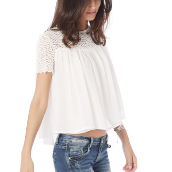 White swing top with floral lace insert