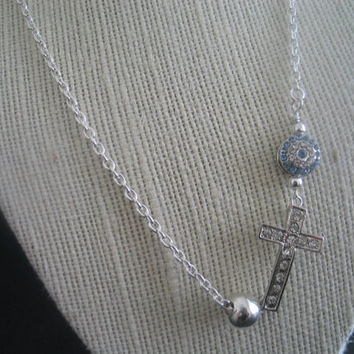 Side cross blue evil eye silver colored necklace