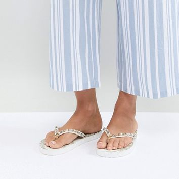 Accessorize whilte and gold Mandala flip flops at asos.com