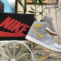 Nike Air Jordan 1 I Retro Hi Flyknit Wolf Grey/Golden Harvest Basketball Sneaker