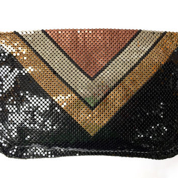 WHITING AND DAVIS!!! Vintage 1970s 'Whiting and Davis' disco clutch with zip top and chevron pattern front