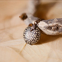 """Embossed  leaves brass locket necklace with tiny mushroom charm and amber glass bead - """"Under the oak tree""""."""