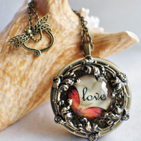 Music box locket,  round locket with music box inside, in bronze with Love and Butterfly  Cabochon