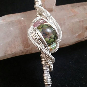 Wire wrapped dab tool with tourmaline and welo Opal.