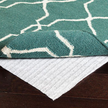 Waves 100% PVC Rug Pad in Various Sizes design by Surya
