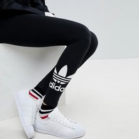 adidas Originals Adicolour Leggings With Double Trefoil Logo at asos.com