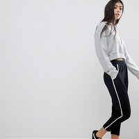 ASOS PETITE Tapered Trousers with Contrast Bind at asos.com