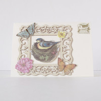 Handmade greeting card - blue bird in a nest, with butterflies and wooden frame