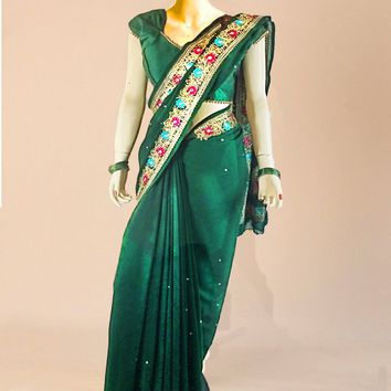 the pine green pure goergette saree with detailed gold trim and large jewel sequins