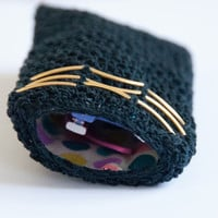 Crocheted sunglass pouch - black and gold