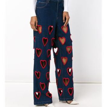 ASHISH   Cut-Out Heart Flared Jeans   brownsfashion.com   The Finest Edit of Luxury Fashion   Clothes, Shoes, Bags and Accessories for Men & Women