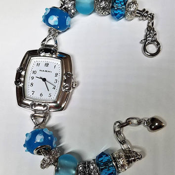 Women's european blue charm bracelet watch, blue and white lampwork glass, blue beach glass, silver butterfly, white crystal beads