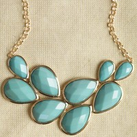 lady in blue teardrop necklace at ShopRuche.com
