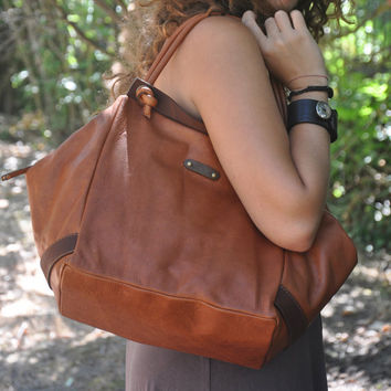 A handmade leather handbag made in soft Italian by iyiamihandbags