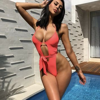 Scandal Cut Out Strappy Brazilian High Rise One Piece