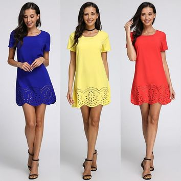 Women's Short Sleeve Summer Mini Dress with Hollow Wavy Hem.    Sizes Small to 2XL.   Colors: Yellow, Blue, Red and Black.   ***FREE SHIPPING***