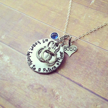 My heart belongs to a Police Officer handstamped sterling silver necklace , swarovski crystal and handcuff and heart charms