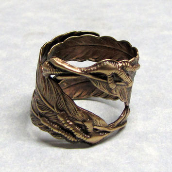 Raven Claw and Feather Ring by ranaway on Etsy