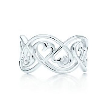 Tiffany & Co. -  Paloma Picasso® Loving Heart swirl band ring in sterling silver.