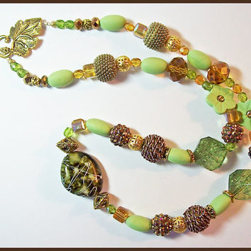 Jesse James beads and Polymer Clay beads Necklace Green and Gold  Handcrafted 23 in.long
