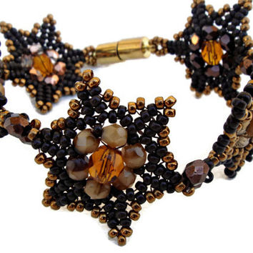 Brown and gold beaded bracelet with Czech faceted. Handmade jewelry. Seed beads jewelry.