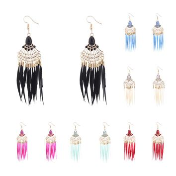 Chandelier gold tone drop earrings with feathers